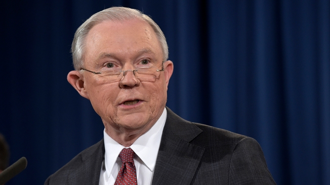 Ferguson Emblem of Tense Relationship With Police: Sessions