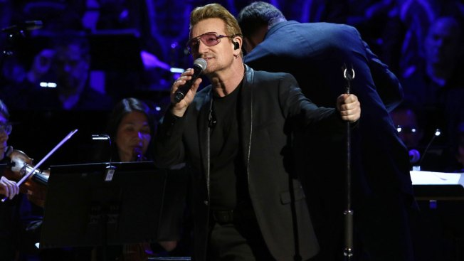 Bono, Joe Biden, Miley Cyrus Celebrate Fight Against AIDS at Concert