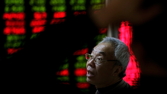 China's market regulators suspend programs that automatically stop trading during declines