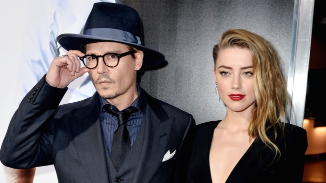 Johnny Depp's Wife Amber Heard Charged With Sneaking Dogs Into Australia