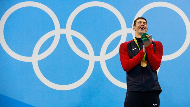 What Made Michael Phelps Chuckle on Medal Stand?