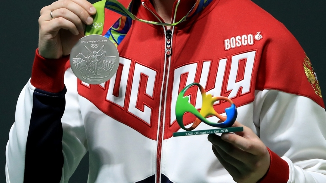 Forget the Flowers, Medal Winners Receive Sculpture Instead