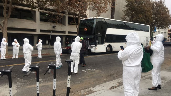 Activists in Hazmat Suit Block Google Bus in San Jose