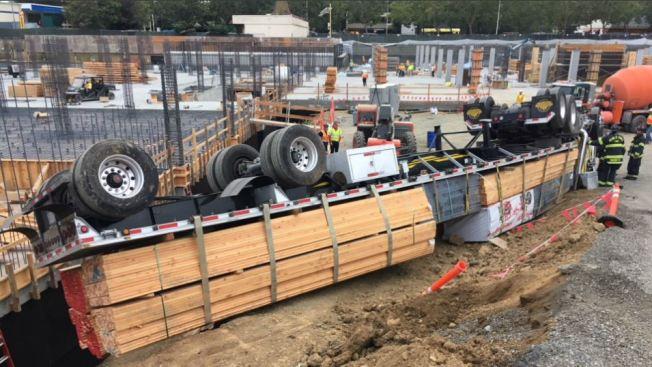 Truck Driver Injured When Lumber Truck Overturns in Menlo Park