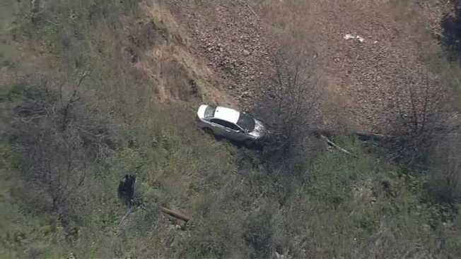 Driver Rescued After Crash Off Cliff in Oakland