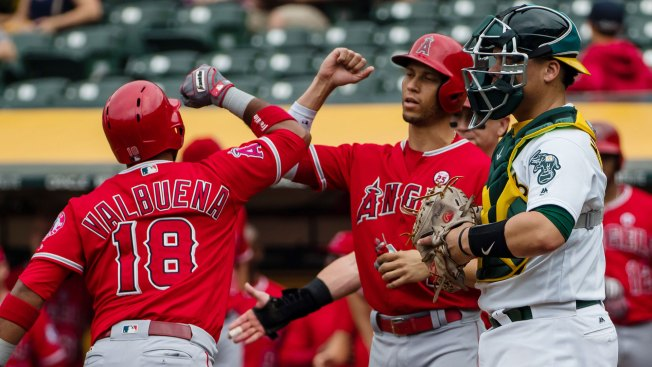 Matt Olson Homers Twice, A's Rally, But Fall to Angels in Extras