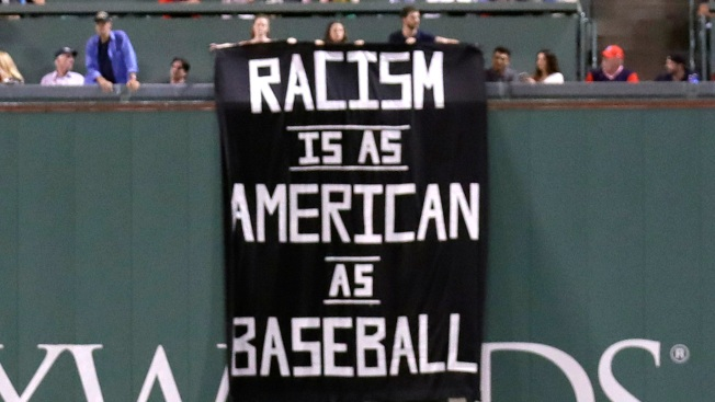 'Racism Is as American as Baseball' Banner Hangs in A's Vs Red Sox Game