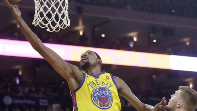 Warriors Lose Curry Early, Ride Durant to Overtime Win Over Spurs