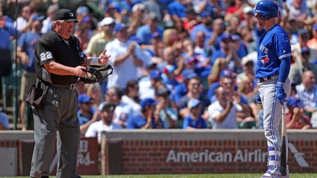 Major League Baseball umpires wear wristbands to protest