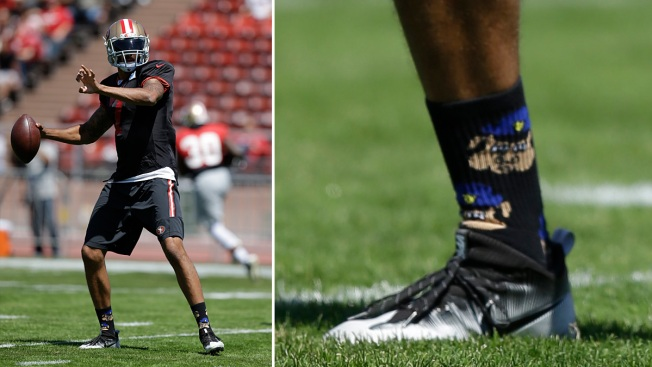 49ers' QB Colin Kaepernick Wears Socks Depicting Police Officers as Pigs