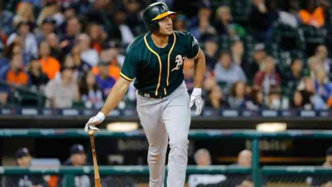 Lowrie's slam helps A's rally from 4 down, beat Tigers 9-8