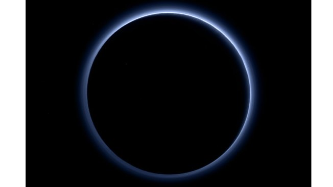 NASA Spacecraft Captures Blue Sky and Red Ice on Pluto