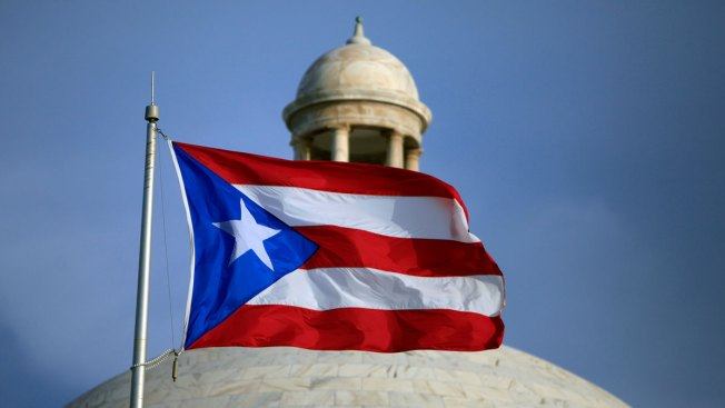 Divided Puerto Ricans vote on whether to become US state