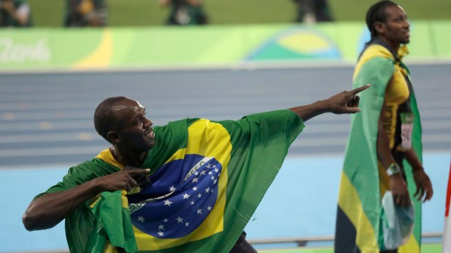 Usain Bolt Throws the Javelin at Olympic Stadium With the Lights Out