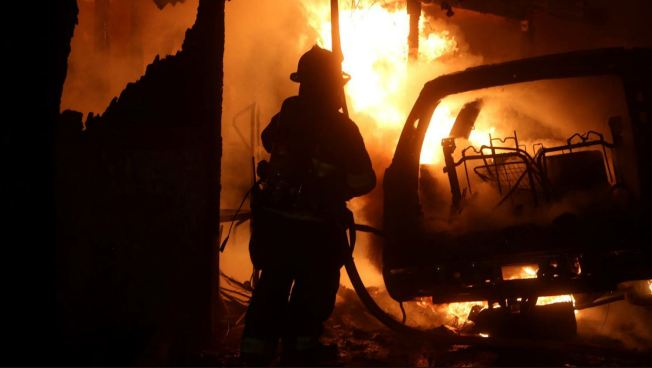 Blaze Torches Home, Several Vehicles in Brentwood