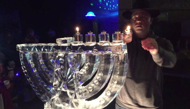 Fire and Ice: Sculptor Creates Menorah From Block of Ice