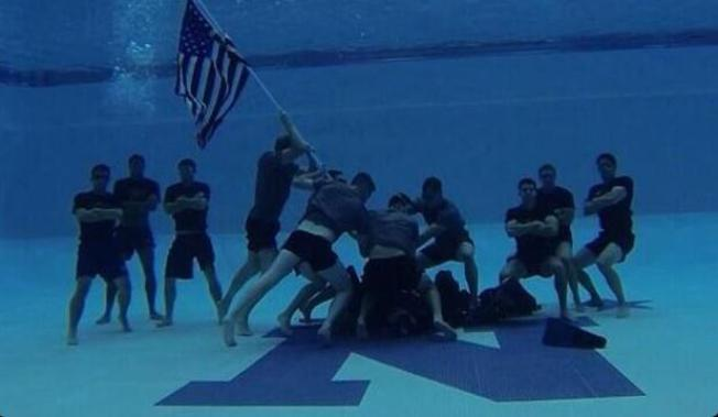 Navy Swimmers Re-Enact Marine Corps War Memorial