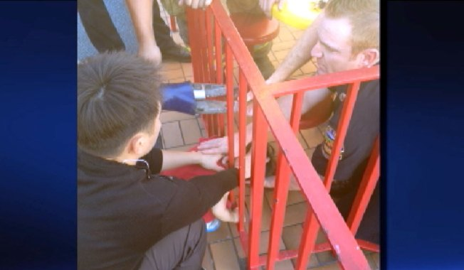 Firefighters Rescue Girl With Head Stuck in McDonald's Fence