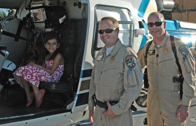 Child Saved by Glowstick Meets Rescuers