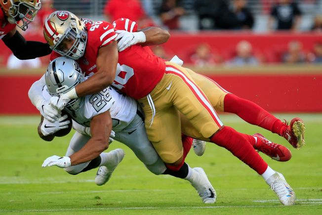3ed752c9666 Warner Showing 49ers He Has the Right Stuff. Getty Images. Niners linebacker  Fred ...