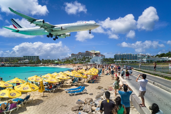 Woman thrown to her death by jet engine blast on Caribbean beach