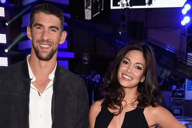 Michael Phelps and Nicole Johnson Share Pics From Beach Wedding