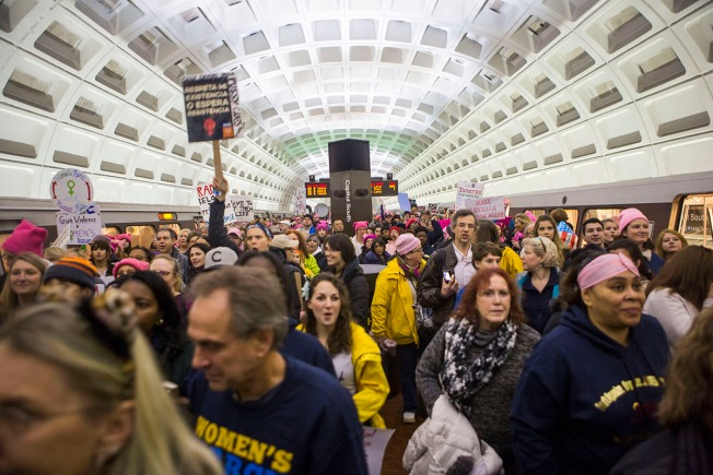 PHOTOS: Riders Pack Metro en Route to Women's March on Washington