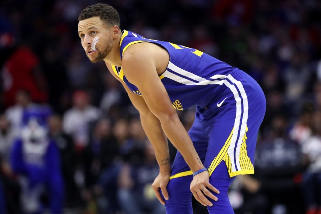 Curry out Wednesday with sprained right ankle, three other starters to sit