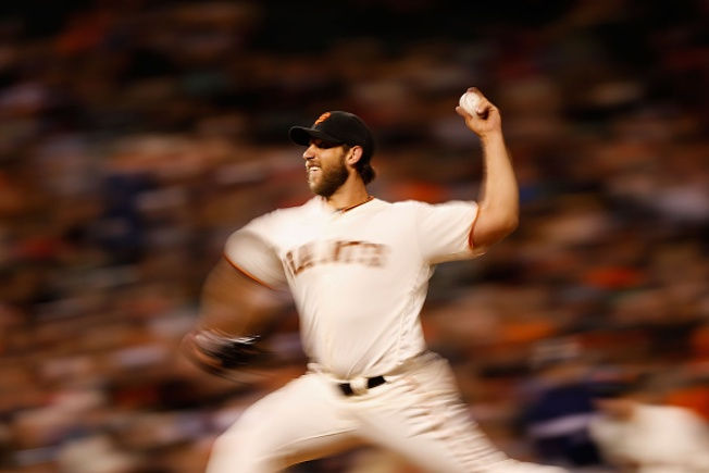 Bumgarner Dominates Brewers With Arm and Bat