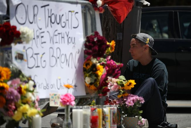 UPS staff return after three warehouse workers shot dead