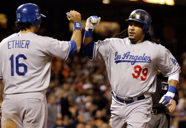 Manny Blasts Off as Dodgers Rout Giants 9-1