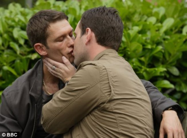 Photo of Gay Couple Kissing Removed from Facebook