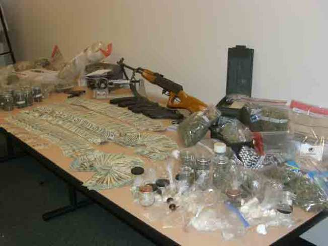 Cache of Firearms, Drugs and Cash Found in SJ Home