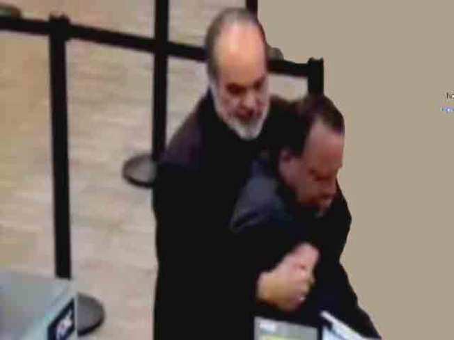 Pulitzer Prize Winner Foils Bank Robber With Bear Hug