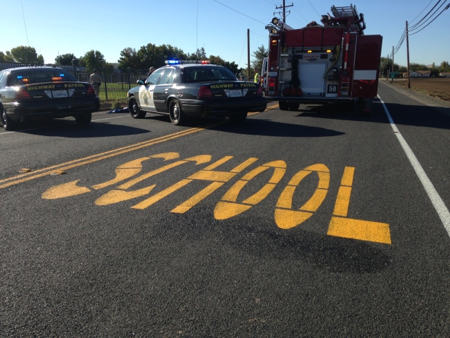 Boy on Bicycle Pinned Under SUV at Byron Middle School