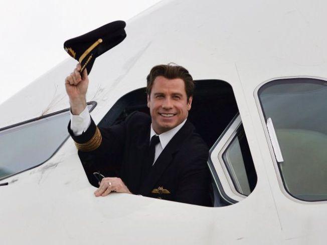 Top Gun: Travolta Piloting Aid to Haiti