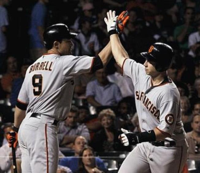 Buster & Cain Keep Giants in First
