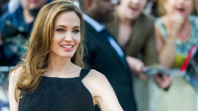 Jolie, Marvel Superheroes Bewitch Disney Expo