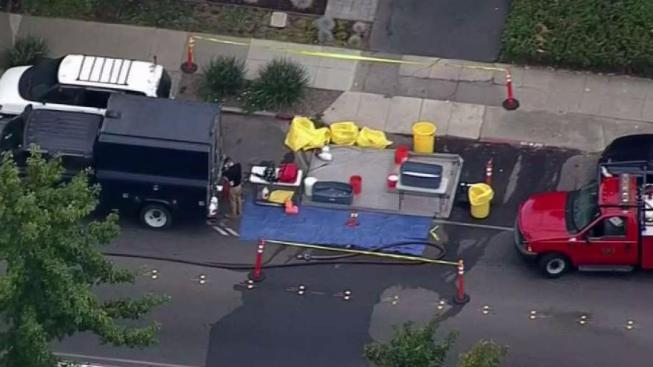 Federal Agents in Hazmat Suits at Scene of DHS, DEA Raid ...