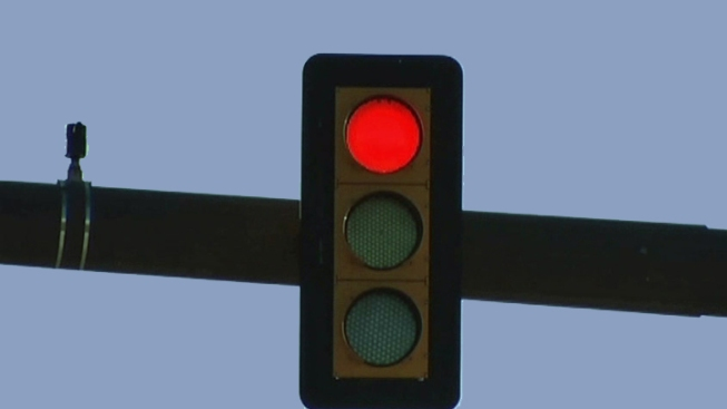 Red Light Camera Maker Named in Class Action Suit