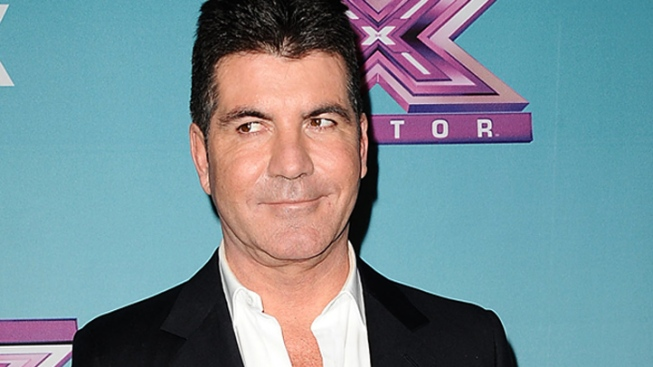 "Simon Cowell Breaks Silence on Baby Drama: ""I'm Proud to Be a Dad"""