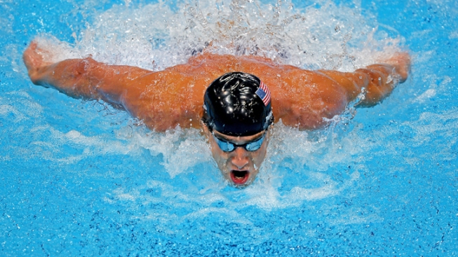 Phelps Back at the Pool, Still Mum on Comeback