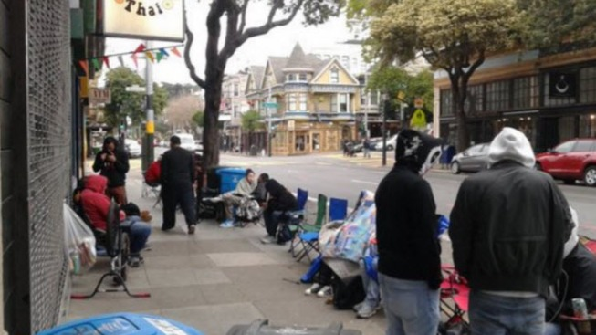 "Diehard Fans Camp Outside SF Sneaker Store for Kanye West's 'Yeezy"" Sneaker Re-Release"