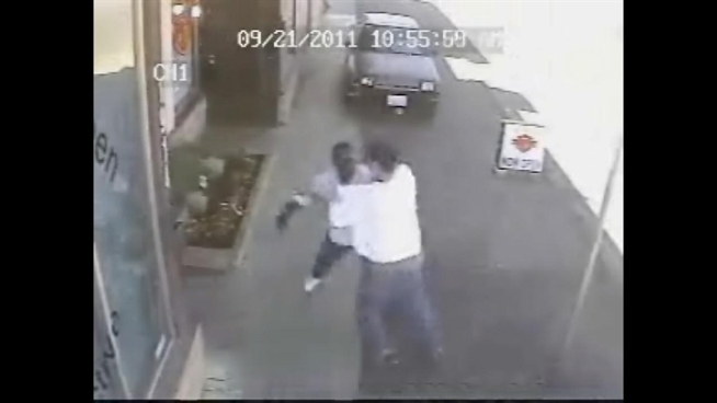 This street fight, caught on a surveillance tape, escalates quickly when one man pulls out a gun. How many felonies can you count?