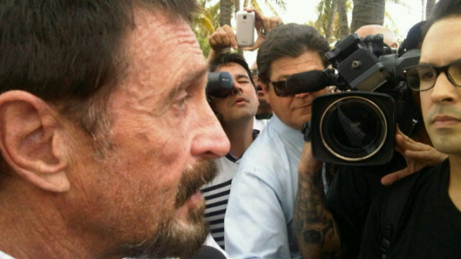 John McAfee, the anti-virus software founder who has evaded Belizean authorities in a homicide investigation, said Thursday that he is glad to be in South Florida. NBC 6 reporter Ari Odzer is among the reporters who spoke to him Thursday in South Beach.