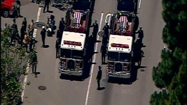 The bodies of two San Francisco firefighters who died in the line of duty were taken into a church for a memorial.