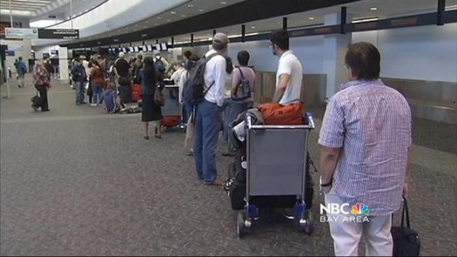 Hurricane Irene causes many cancellations and strands passengers at San Francisco International Airport.