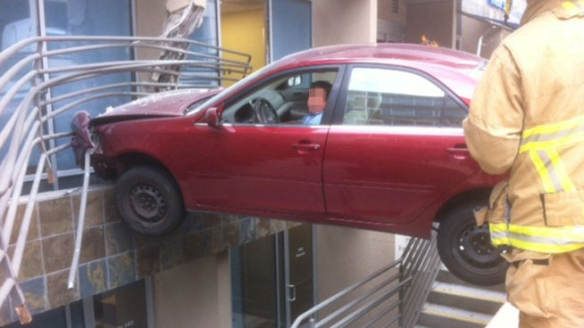 Car Suspended Over Building