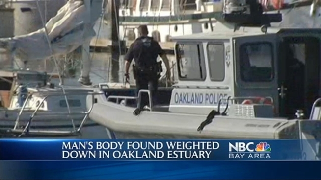 A body found weighted down in the Oakland Estuary was found around 6:30 this morning.