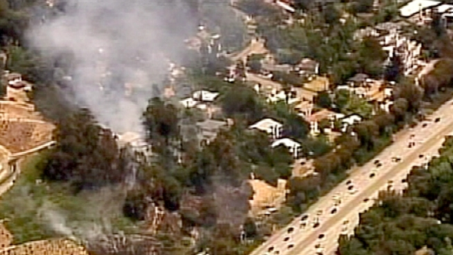 Oakland firefighters battled a three-alarm grass fire Friday afternoon after a car crashed into a power pole. NBC Bay Area's Cheryl Hurd reports.